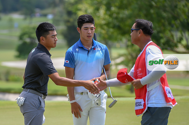 Lloyd Jefferson GO (PHI) shakes hands after going 5 under for the early lead during Rd 1 of the Asia-Pacific Amateur Championship, Sentosa Golf Club, Singapore. 10/4/2018.<br /> Picture: Golffile | Ken Murray<br /> <br /> <br /> All photo usage must carry mandatory copyright credit (© Golffile | Ken Murray)