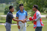 Lloyd Jefferson GO (PHI) shakes hands after going 5 under for the early lead during Rd 1 of the Asia-Pacific Amateur Championship, Sentosa Golf Club, Singapore. 10/4/2018.<br /> Picture: Golffile | Ken Murray<br /> <br /> <br /> All photo usage must carry mandatory copyright credit (&copy; Golffile | Ken Murray)