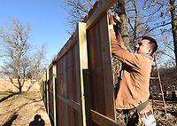 NWA Democrat-Gazette/FLIP PUTTHOFF <br /> ONE PLANK AT A TIME<br /> Jose Flores builds a cedar fence Tuesday Jan. 9 2019 in the Prairie Creek area. Flores and a crew built the fence behind a business on Arkansas 12.