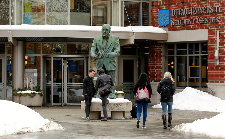 DePaul University students make their way across the Lincoln Park Campus near the Student Center on Tuesday, Feb. 18, 2014 following several weeks of snow fall during winter. (DePaul University / Rae Kirby)