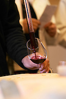 sampling wine with a pipette from a barrel ch gd barrail lamarzelle figeac saint emilion bordeaux france