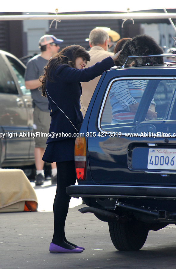 January 17th 2013   <br /> <br /> <br /> Zooey Deschanel wearing a blue blazer jacket coat purple shoes running falling over picking up a trash can while filming the tv show New Girl in Los Angeles<br /> Zooey was getting into a green car with loads of cats on the roof &amp; she pet them. <br /> <br /> AbilityFilms@yahoo.com<br /> 805 427 3519 <br /> www.AbilityFilms.com