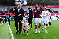 (L-R) Lee Trundle, Cameron Carter-Vickers and Barrie McKay of Swansea City applauds the fans at the final whistle during the Sky Bet Championship match between Swansea City and Hull City at the Liberty Stadium in Swansea, Wales, UK. Saturday 27 April 2019