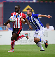 Lincoln City's John Akinde vies for possession with Sheffield Wednesday's Julian Borner<br /> <br /> Photographer Chris Vaughan/CameraSport<br /> <br /> Football Pre-Season Friendly - Lincoln City v Sheffield Wednesday - Saturday July 13th 2019 - Sincil Bank - Lincoln<br /> <br /> World Copyright © 2019 CameraSport. All rights reserved. 43 Linden Ave. Countesthorpe. Leicester. England. LE8 5PG - Tel: +44 (0) 116 277 4147 - admin@camerasport.com - www.camerasport.com