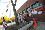 Voters wait in line outside a firehouse polling place on election day in the Lincoln Park neighborhood of Chicago, Illinois on November 4, 2008.  Predominantly upper income, white residents in the neighborhood are a major source of local contributions to Barack Obama's senate and presidential campaigns.