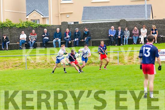 An Ghaeltacht's Cathal Ó Fiannachta challenged from both sides as Mary's men Darragh O'Sullivan & Conor O'Shea brigh him to ground but Ó Fiannachta still managed to get the ball away to Sean M.Ó Conchúir.