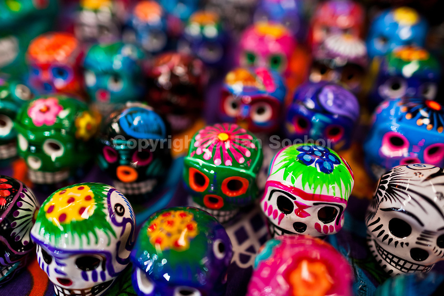 Colorful painted skulls (Calaveras) are sold on the market during the Day of the Dead celebration in Mexico City, Mexico, 28 October 2016. Skulls, skeletons and the other death symbols are used to adorn graves, altars and offerings during the Day of the Dead (Día de Muertos). A syncretic religious holiday, combining the death veneration rituals of the ancient Aztec culture with the Catholic practice, is celebrated throughout all Mexico. Based on the belief that the souls of the departed may come back to this world on that day, people gather at the gravesites in cemeteries, praying, drinking and playing music, to joyfully remember friends or family members who have died and to support their souls on the spiritual journey.