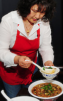 Jenny Yin serves Chinese soup at Yen Ching restaurant on Saturday, September 7, 2008, on the west side of Madison, Wisconsin