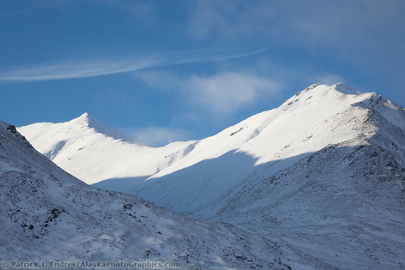 Snow covered Brooks Range mountains near the continental divide in Alaska.