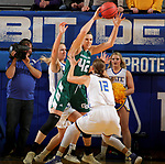 SIOUX FALLS, SD - NOVEMBER 29: Mackenzie Wolf #42 from Wisconsin Green Bay passes the ball out of a double team including Tagyn Larson #24 and Macy Miller #12 from South Dakota State during their game Thursday night at Frost Arena in Brookings. (Photo by Dave Eggen/Inertia)