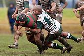 Pat Taala wrestles Mark Muir to ground. Counties Manukau Premier Semi-final rugby game between Manurew & Waiuku, played at Mountfort Park Manaurewa on Saturday 1st of August 2009..Waiuku won 23 - 3 and will meet Patumahoe in the final next week at Growers Stadium.