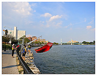 NEW YORK, NY - AUGUST 23: Rowboat in the East river on 94th street- FDR Drive in Yorkville, New York on August 23, 2012. Photo Credit: Thomas R Pryor