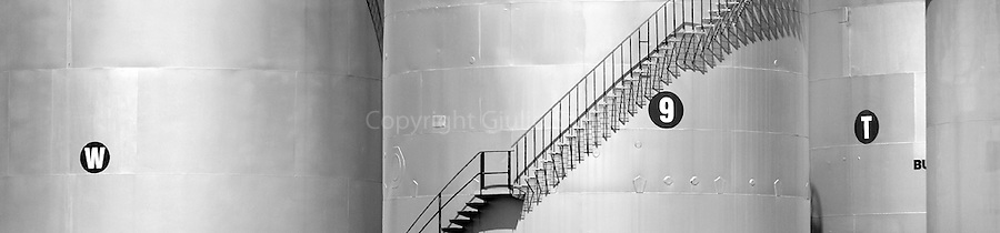 Stairs run up the side of one of the tanks at the bulk liquids storage terminal, located beside the Brisbane River at Hamilton.