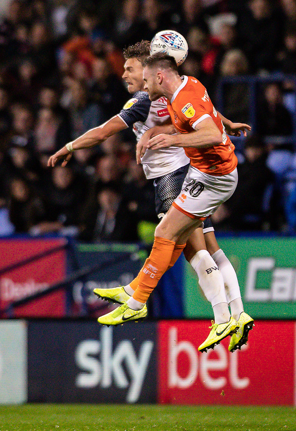 Bolton Wanderers' Dennis Politic competing with Blackpool's Oliver Turton (right) <br /> <br /> Photographer Andrew Kearns/CameraSport<br /> <br /> The EFL Sky Bet League One - Bolton Wanderers v Blackpool - Monday 7th October 2019 - University of Bolton Stadium - Bolton<br /> <br /> World Copyright © 2019 CameraSport. All rights reserved. 43 Linden Ave. Countesthorpe. Leicester. England. LE8 5PG - Tel: +44 (0) 116 277 4147 - admin@camerasport.com - www.camerasport.com