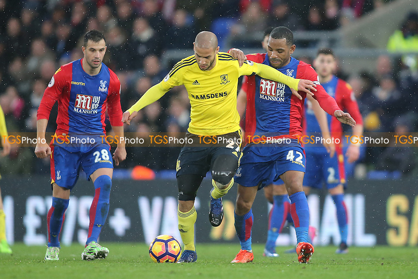 Adlene Guedioura of Middlesbrough and Jason Puncheon of Crystal Palace during Crystal Palace vs Middlesbrough, Premier League Football at Selhurst Park on 25th February 2017