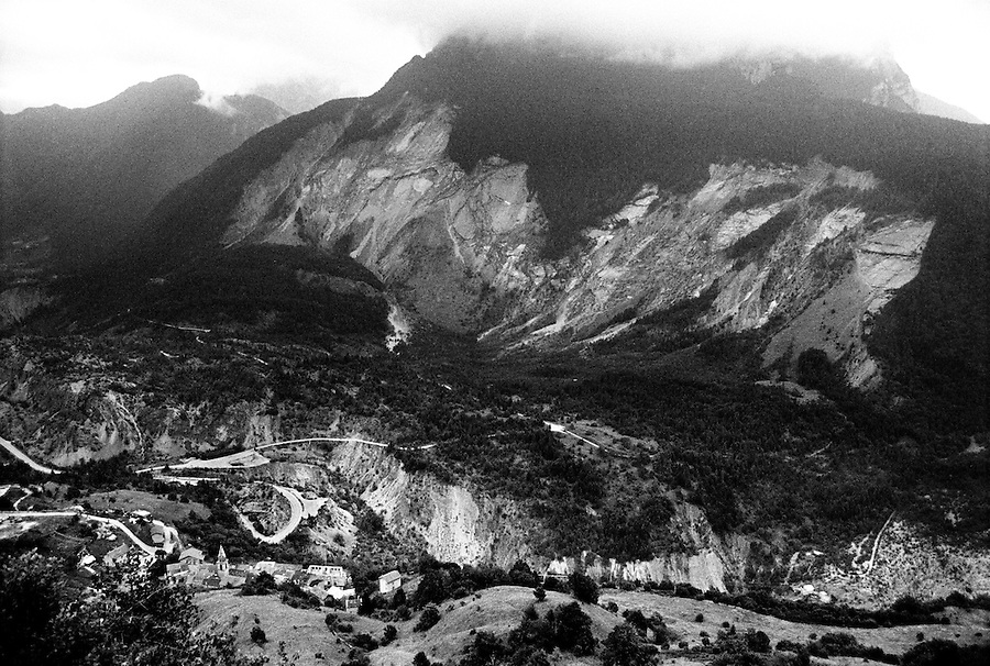 The 2km wide landslide carried 260 million cubic metre of rock into the lake. On October 9th 1963 a giant landslide collapses into the artificial lake created by the Vajont Dam in northern Italy, provoking a 250 meters high wave that completely destroys the settlements near the lake and the town of Longarone far down in the valley below the dam. 1910 people lost their lives in a tragedy that easily could have been avoided if it was not for the economical and political interests of powerful men dreaming of the tallest dam in the world. A tragedy that is still alive today in Erto, Casso and Longarone, where the survivers of that disastrous day almost 50 years ago are still fighting for their justice.