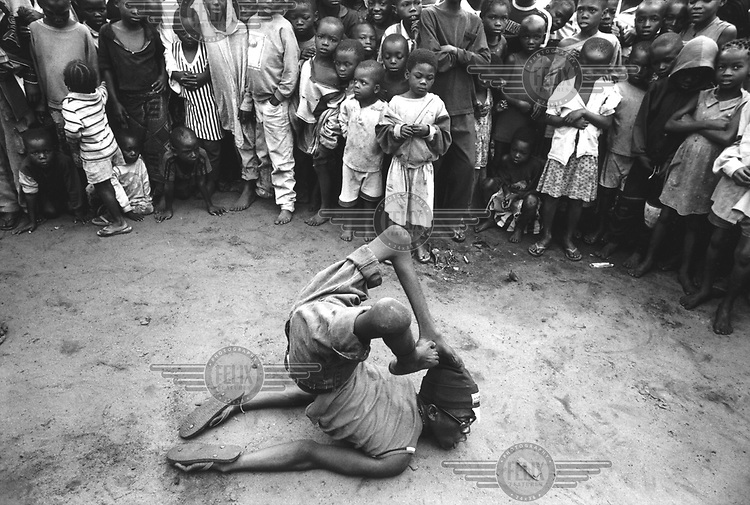 © Dieter Telemans / Panos Pictures..Music in Kinshasa, Democratic Republic of Congo. 12/2001..Performance of the group 'Super Succes Lokendo' for a funeral in the cit?. Whenever the family members of the deceased can pay for it, they will invite musicians for a performance.