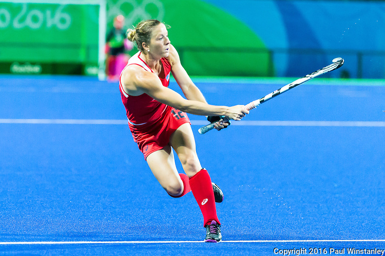 Julia Reinprecht #12 of United States follows through after her pass during USA vs Japan in a Pool B game at the Rio 2016 Olympics at the Olympic Hockey Centre in Rio de Janeiro, Brazil.