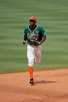 Greensboro Grasshoppers center fielder Thomas Jones (12) jogs to the dugout in between innings during a game against the Lakewood BlueClaws on June 10, 2018 at First National Bank Field in Greensboro, North Carolina.  Lakewood defeated Greensboro 2-0.  (Mike Janes/Four Seam Images)