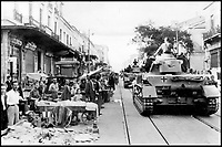 BNPS.co.uk (01202 558833)Pic:    Pen&Sword/BNPS<br /> <br /> In a display of power to locals, a column of German Panzer tanks advance along a road in Tripoli.<br /> <br /> Fascinating rare photos of Rommel's feared Afrika Korps which terrorised the Allies in the desert have come to light in a new book.<br /> <br /> Under the direction of legendary German commander Field Marshal Erwin Rommel, who was nicknamed the Desert Fox, the corps were recognised as a superb fighting machine.<br /> <br /> They achieved their greatest triumph when they outmanoeuvred the British at the Battle of Gazala in June 1942 which led to them capturing Tobruk in Libya.<br /> <br /> But they were ultimately defeated in the iconic Battle of Alamein when they succumbed to an offensive led by Field Marshal Bernard Montgomery.