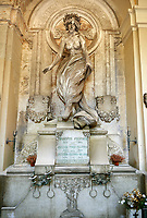 Picture and image of the Art Nouveau stone sculpture of a nude. The Pizzorini Tomb by Vittorio  Lavezzari 1906. Section A, no 33, The monumental tombs of the Staglieno Monumental Cemetery, Genoa, Italy