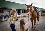 LOUISVILLE, KY - MAY 02: A mother and daughter pet a pony during workouts at Churchill Downs on May 2, 2018 in Louisville, Kentucky. (Photo by Alex Evers/Eclipse Sportswire/Getty Images)