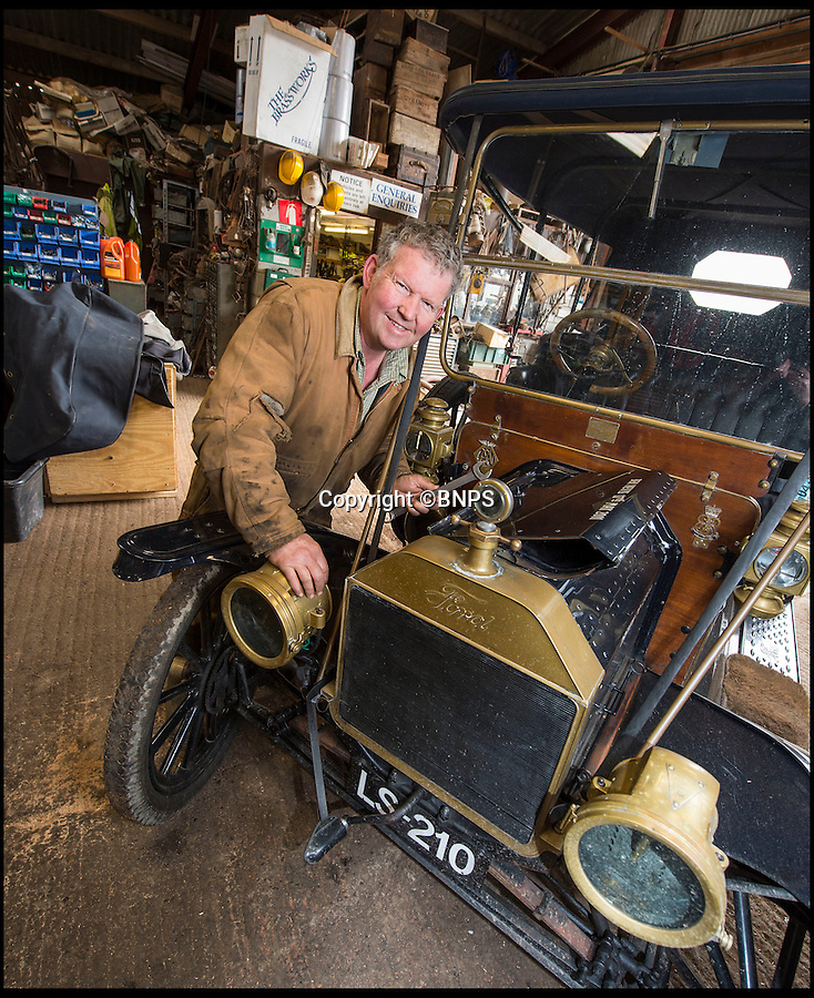 BNPS.co.uk (01202 558833)<br /> Pic: PhilYeomans/BNPS<br /> <br /> Garage that time forgot...<br /> <br /> Business is booming at Neil Tuckets time warp garage in the heart of Buckinghamshire - Where you can by any car…as long as its a Model T Ford.<br /> <br /> Despite his newest models being nearly 90 years old, Neil struggles to keep up with demand with customers snapping up one a week, despite their rudimentary levels of comfort and trim.<br /> <br /> Neil sources his spares from all over the globe and carefully puts the machines back together again.<br /> <br /> 'There like a giant meccano set really, and so beautifully simple and reliable they just won't let you down...You also don't require road tax or and MOT!'
