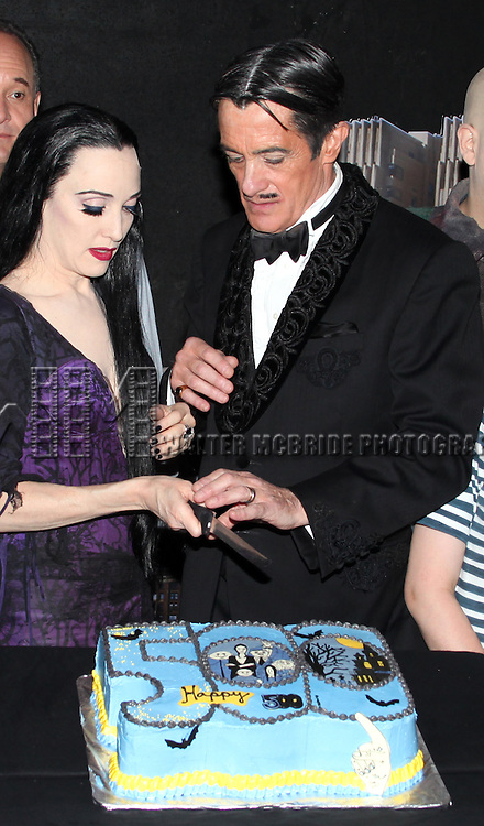Bebe Neuwirth & Roger Rees.with the cast of 'The Addams Family' celebrating their 500th performance with a special cake-cutting backstage at the Lunt Fontanne Theatre in New York City.
