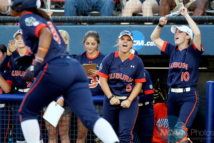 06 JUNE 2016: The Auburn University bench cheers on their hitter against University of Oklahoma during the Division I Women's Softball Championship held at ASA Hall of Fame Stadium in Oklahoma City, OK.  University of Oklahoma defeated Auburn University in Game 1 by the final score of 3-2. Shane Bevel/NCAA Photos