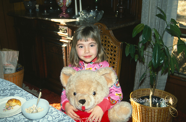 Girl with stuffed bear and breakfast