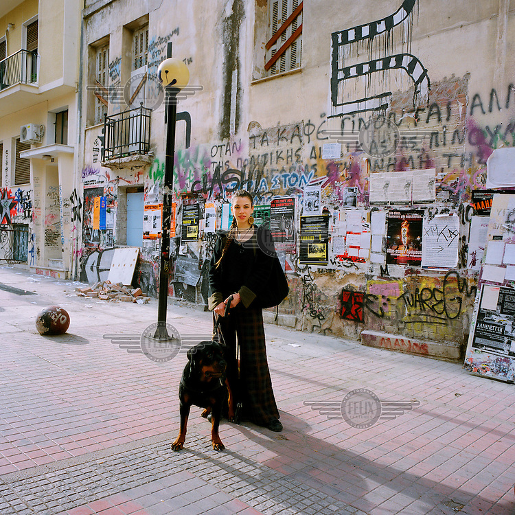 21 year old Eva, pictured with her Rottweiler dog, lives and studies in the Exarchia neighbourhood of central Athens. Exarchia has a rich history of radicalism. Ever since the foundation of the National Technical University in 1836, the area has been home to anarchists, free thinkers, artists, intellectuals and students..