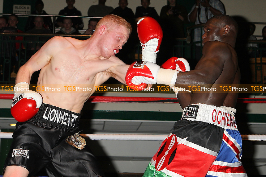 Luke Robinson (black shorts) defeats Erick Ochieng in a Super-Middleweight boxing contest at York Hall, Bethnal Green, promoted by Spencer Fearon / Hard Knocks - 18/03/11 - MANDATORY CREDIT: Gavin Ellis/TGSPHOTO - Self billing applies where appropriate - Tel: 0845 094 6026