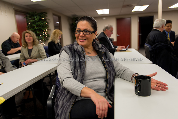 2/13/2013--Bellevue, WA, USA..Natasha Savage at a weekly meeting at the AU Business Club, a small business networking group founded by another Russian immigrant in Bellevue, Olga von Houck. Many Russian speakers come to type club's events to network...Natasha Savage, whose Armenian Jewish family arrived from Azerbaijan 25 years ago, notes the same sort of insularity among the nearly 100,000 Russian speakers in King County, many of whom live in Kirkland, Redmond, and other Eastside locales....©2013 Stuart Isett. All rights reserved.