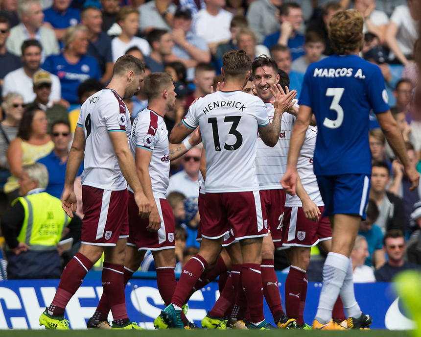 Burnley's Stephen Ward (2nd right) celebrates scoring his sides second goal with team mates<br /> <br /> Photographer Craig Mercer/CameraSport<br /> <br /> The Premier League - Chelsea v Burnley - Saturday August 12th 2017 - Stamford Bridge - London<br /> <br /> World Copyright &copy; 2017 CameraSport. All rights reserved. 43 Linden Ave. Countesthorpe. Leicester. England. LE8 5PG - Tel: +44 (0) 116 277 4147 - admin@camerasport.com - www.camerasport.com