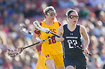 Los Angeles, CA 02/09/13 - Nancy Dunbar  (Northwestern #22) and Kaitlyn Couture (USC #18) in action during the Northwestern vs USC NCAA Women Lacrosse game at the Los Angeles Colliseum.