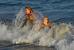 Girls body surfing in Santa Cruz