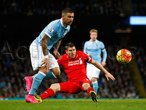 21.11.2015. The Etihad, Manchester, England. Barclays Premier League. Manchester City versus Liverpool. Manchester City defender Aleksandar Kolarov beats Liverpool skipper James Milner to the ball.