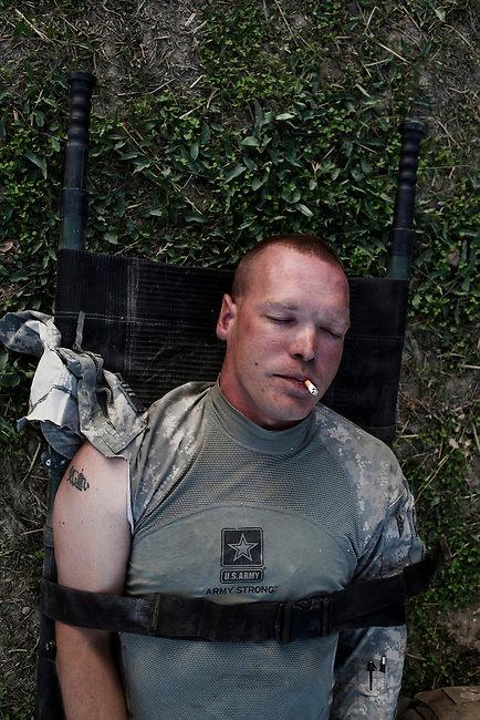 Sgt 1st Class Chet Millard from RCP 5 of the 9-51 Engineer Company, Sappers from the 276th Engineer Battalion serving with the Army National Guard out of Rhinelander, WI, US Army, lays on a stretcher awaiting medical evacuation helicopters after he was injured in an Improvised Explosive Device (IED) attack on the Mine Resistant Ambush Protected Vehicle (MRAP) he was traveling in, in the Tangi Valley, Wardak Province, Afghanistan, on September 8, 2009. Three US soldiers were injured in the IED attack. Photo by Adam Ferguson/VII Mentor