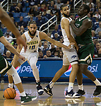 Nevada's Cody Martin, center, sets a screen on Colorado State's Che Bob, for his twin brother Caleb in the first half of an NCAA college basketball game in Reno, Nev., Sunday, Feb. 25, 2018. (AP Photo/Tom R. Smedes)
