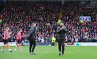 Lincoln City's assistant manager Nicky Cowley, left, and Lincoln City manager Danny Cowley prior to kick off<br /> <br /> Photographer Chris Vaughan/CameraSport<br /> <br /> The EFL Sky Bet League Two - Lincoln City v Grimsby Town - Saturday 19 January 2019 - Sincil Bank - Lincoln<br /> <br /> World Copyright © 2019 CameraSport. All rights reserved. 43 Linden Ave. Countesthorpe. Leicester. England. LE8 5PG - Tel: +44 (0) 116 277 4147 - admin@camerasport.com - www.camerasport.com