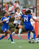 In a National Women's Soccer League Elite (NWSL) match, Portland Thorns FC defeated the Boston Breakers, 2-1, at Dilboy Stadium on July 21, 2013.  Boston Breakers defender Jazmyne Avant (5) and Boston Breakers defender Kia McNeill (14) keep Portland Thorns FC forward Alex Morgan (13) from the ball.