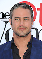 "WESTWOOD, CA - APRIL 21:  Taylor Kinney at the Los Angeles premiere of ""The Other Woman"" at the Regency Village Theater on April 21, 2014 in Westwood, California. SPPG/MPI/Starlitepics /NortePhoto.com"