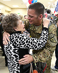 Chief Warrant Officer II Josh Groth hugs his grandmother Clo Groth as he and fellow Nevada Army Guard soldiers arrive at the Reno-Tahoe International Airport in Reno, Nev., on Sunday, Feb. 16, 2014. About 300 supporters greeted the 1/168th General Support Battalion after a 10-month deployment in Afghanistan. (Las Vegas Review-Journal/Cathleen Allison)
