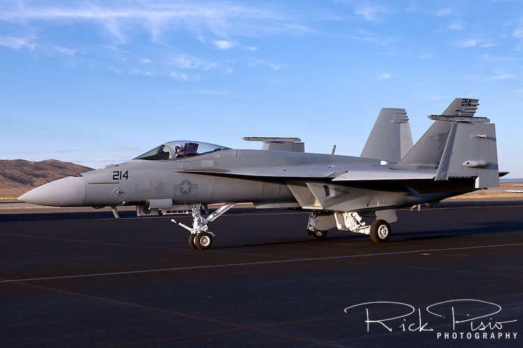 Boeing F/A-18E/F Super Hornet taxiing with wing tips folded.