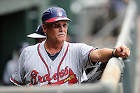 Manager Randy Ingle (12) of the Rome Braves looks out from the dugout before a game against the Greenville Drive on Sunday, June 14, 2015, at Fluor Field at the West End in Greenville, South Carolina. Greenville won, 10-8. (Tom Priddy/Four Seam Images)