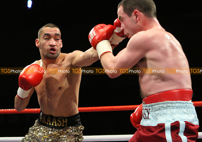 Akaash Bhatia (gold shorts) defeat Mickey Coveney in a Featherweight boxing contest at the Brentwood Centre, promoted by Frank Maloney - 23/01/10 - MANDATORY CREDIT: Gavin Ellis/TGSPHOTO - Self billing applies where appropriate - Tel: 0845 094 6026