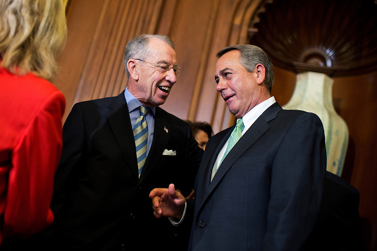 UNITED STATES - MAY 21: Speaker John Boehner, R-Ohio, right, talks with Sen. Charles Grassley, R-Iowa, during a bill signing ceremony in the Capitol's Rayburn Room for the Justice for Victims of Trafficking Act, May 21, 2015. (Photo By Tom Williams/CQ Roll Call)