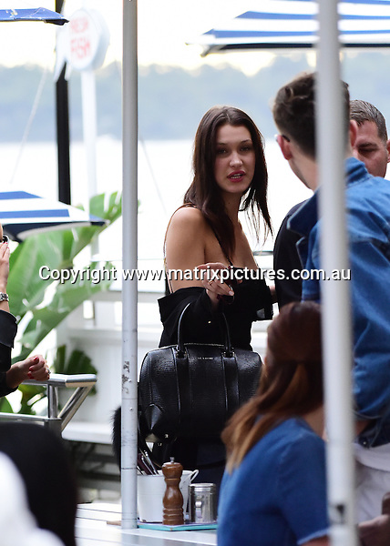 15 MAY 2016 SYDNEY AUSTRALIA<br /> WWW.MATRIXPICTURES.COM.AU <br /> <br /> NON EXCLUSIVE PICTURES<br /> <br /> Bella Hadid pictured at Icebergs Bondi going for a sneaky cigarette and later stopping off at Watsons Bay Hotel for a refreshment. <br /> <br /> *ALL WEB USE MUST BE CLEARED*<br /> <br /> Please contact prior to use:  <br /> <br /> +61 2 9211-1088 or email images@matrixmediagroup.com.au <br /> <br /> Note: All editorial images subject to the following: For editorial use only. Additional clearance required for commercial, wireless, internet or promotional use.Images may not be altered or modified. Matrix Media Group makes no representations or warranties regarding names, trademarks or logos appearing in the images.