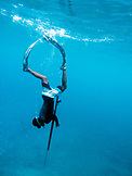 INDONESIA, Mentawai Islands, Kandui Resort,  free diver making a dive to spear a fish