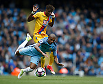 Fernandinho of Manchester City fouled by Wilfried Zaha of Crystal Palace during the English Premier League match at the Etihad Stadium, Manchester. Picture date: May 6th 2017. Pic credit should read: Simon Bellis/Sportimage